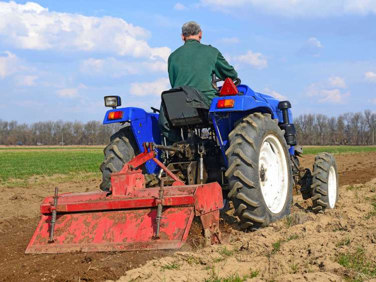 Farmer on tractor handles field. Cat 1 implements.